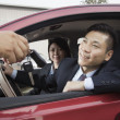 Mechanic Giving Car Keys to Couple — Stock Photo