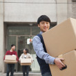 Family moving boxes out of a dormitory at college — Stock Photo #36402791