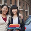 Stock Photo: Mother and daughter portrait in front of dormitory