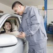 Stock Photo: Mechanic Explaining to Businesswoman
