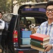 Stock Photo: Boy unpacking car for college