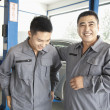 Stock Photo: Two Garage Mechanics