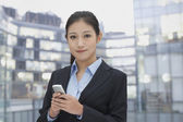 Businesswoman using her phone — Stock Photo