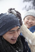 Couple Having a Snowball Fight — Stock Photo