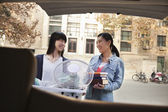 Sisters moving into dormitory at college — Stock Photo