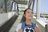Girl standing next to the escalator — Stock Photo