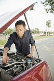Mechanic Fixing Car by Roadside — Stock Photo