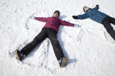 Man and Woman Lying on the Snow — Stock Photo