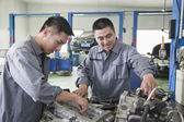 Two Mechanics Working on Car Engine — Stock Photo