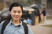 Student portrait in front of dormitory at college — Stock Photo