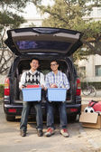 Father and son unpacking car for college — Stock Photo