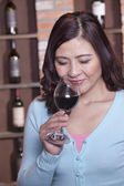 Woman Smelling a Glass of Wine — Stock Photo
