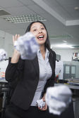 White-collar worker throwing paper in office — Stock Photo
