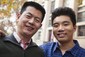 Father and son portrait in front of dormitory — Stock Photo
