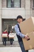 Family moving boxes out of a dormitory at college — Stock Photo