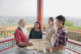 Chinese Family Playing Chinese Chess — Stock Photo