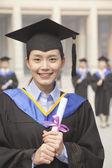 Graduate Holding Diploma — Stock Photo