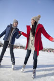 Couple skating at ice rink — Stock Photo