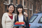 Mother and daughter portrait in front of dormitory — Stock Photo
