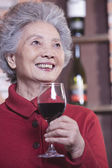 Senior Woman Holding Glass of Wine — Stock Photo