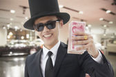 Rich Man Showing Off His Money — Stock Photo