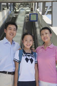 Family standing next to the escalator — Stock Photo