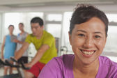 Woman exercising on the exercise bike — Stock Photo