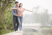 Boyfriend and Girlfriend by a Canal — Stock Photo