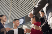People looking at tickets at the railway station — Stock Photo