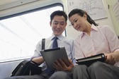Business couple working in the subway — Stock Photo