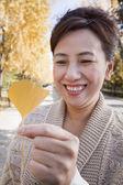 Mature Woman Holding Yellow Ginkgo Leaf — Stock Photo