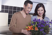 Mature Couple Looking at Flowers — Stock Photo