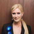 Stock Photo: Businesswomwearing rosette