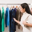 Woman in clothes shop — Stock Photo