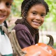 Stock Photo: Kids with pumpkins