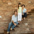 Stock Photo: Family on steps