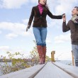 Stock Photo: Couple walking holding hands