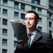 Businessmreading newspaper — Stock Photo #36418943
