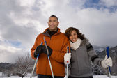 Mature couple skiing — Stock Photo
