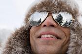 Man wearing deerstalker hat and sunglasses — Stock Photo
