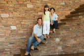 Family on steps — Stock Photo