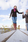 Couple walking holding hands — Stock Photo