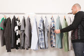 Man in a clothes shop — Stock Photo