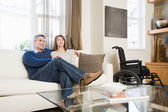Couple relaxing in living room — Stock Photo