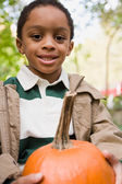 Boy holding a pumpkin — Stock Photo