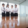 Business people standing by conference table — Stock Photo #36638959