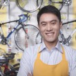 Male mechanic in bicycle store — Stock Photo