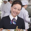 Stock Photo: Hostess Presenting Gourmet Dish