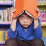 Unhappy Boy with Book — Stock Photo