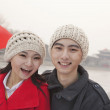 Couple holding Chinese flag outdoors in wintertime — Stock Photo